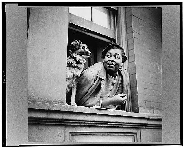 gordon-parks-a-woman-and-her-dog-harlem-section-ny-may-1943